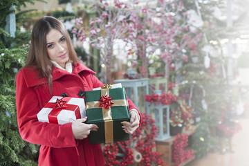 woman buys christmas gifts