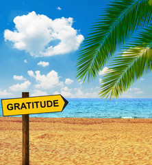 Tropical beach and direction board saying GRATITUDE