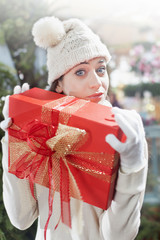 surprised girl, holding tight, her gift