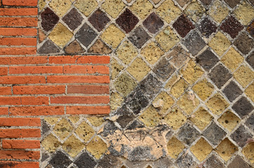 Ancient masonry renewed with modern brickwall