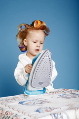 little funny housewife with iron