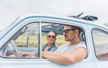 couple on a vintage car