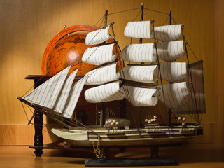 model sailing ship and old globe