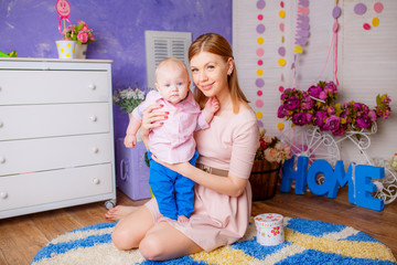 happy mother with her son in the nursery