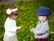 little boy and girl with dandelions