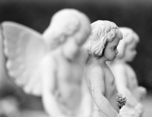 cemetery angel statues with flowers in hands