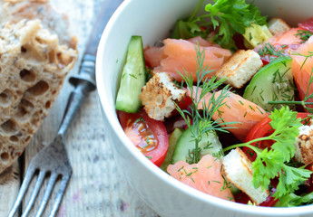 Bowl with salad with smoked salmon and vegetables