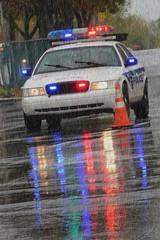 Police car in the rain