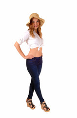 Woman in jeans and hat.