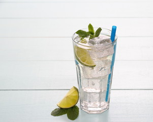 Refreshment cocktail with lime, mint and ice cubes