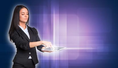 Beautiful businesswomen in suit using digital tablet