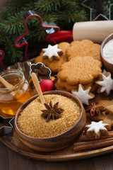 Christmas cookies and ingredients for baking, close-up, vertical
