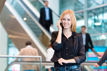 young business woman at a trade fair