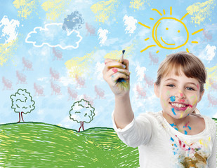Young child drawing a landscape
