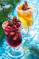 Christmas mulled wine and apple cider on a blue background