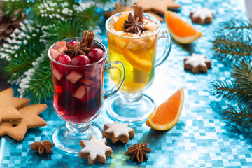Christmas mulled wine and spiced apple cider on blue background