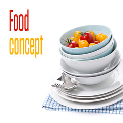 clean bowls, plates and assorted cherry tomatoes, isolated