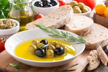 fresh olive oil in plate and Italian snacks