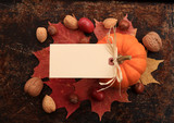 Fototapety Blank cream tag on top of maple leaves, nuts and pumpkin