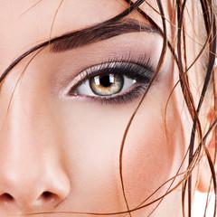 Closeup female eye with dark brown eye makeup