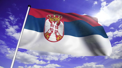 flag of Serbia with fabric structure against a cloudy sky
