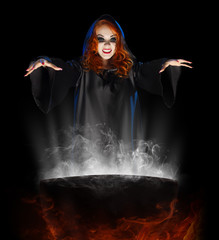 Young witch with cauldron
