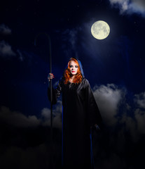 Witch on night sky background
