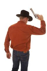 back of a cowboy holding up a pistol