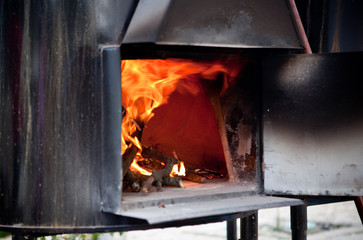 Black iron oven on fire