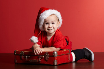 little boy with christmas suitcase