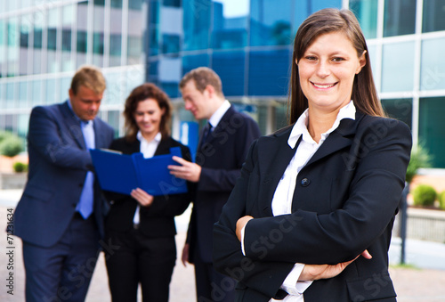 canvas print picture Group of business people with businesswoman leader on foreground