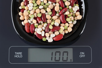 Mixed legume beans on kitchen scale