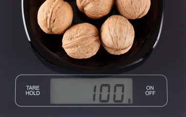 Walnuts on kitchen scale