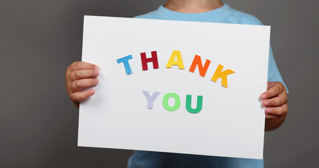 Thank You sign in children's hands