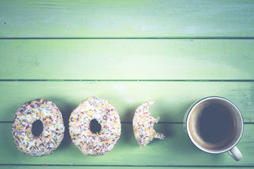 eating donut with coffee for breakfast