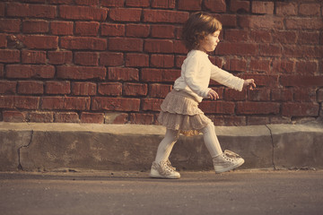 little girl walking away