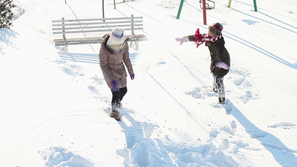 Girls having fun in snow