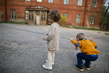 boy and girl playing on street
