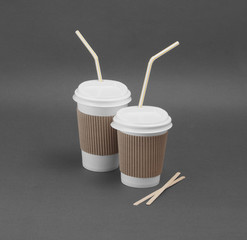 Clotheded take-out coffee with cup holder.