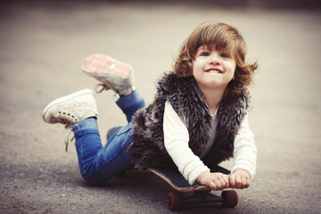 cute little hipster girl with skateboard