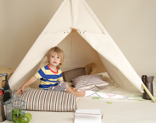 Child Playing Indoors with Teepee Tent