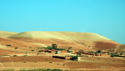 Morocco, house at the foot of a hill in the desert