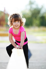 little fit girl plays on playground