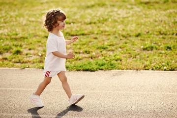 cute girl running at stadium photo