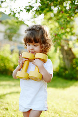 cute little girl with dumbbells