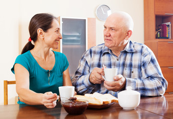 mature couple having tea with jam