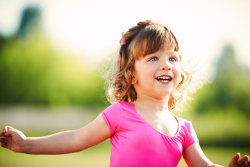 little curly happy girl running portrait