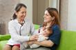 doctor examining newborn baby