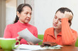 Mature mother scolds daughter for bills or credits