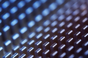 Abstract macro metal teeth pattern, shallow depth of field.
